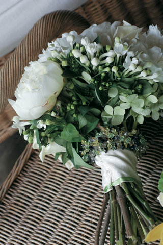 brides-bouquet-of-white-and-green-flowers-and-greenery