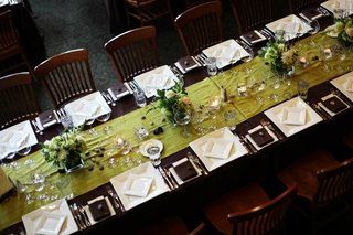 long-wood-reception-table-with-green-runner