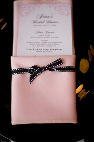 pink-napkin-tied-with-black-ribbon