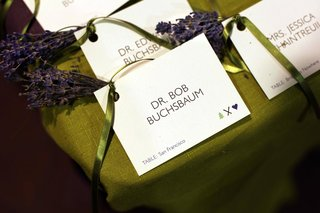 white-seating-card-with-green-ribbon-and-lavender