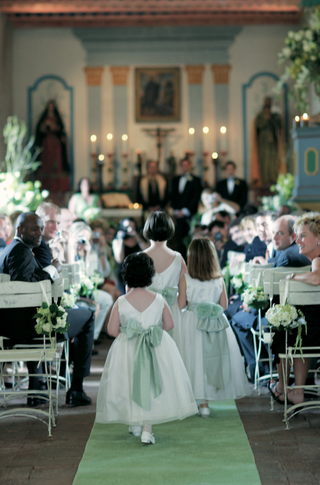 flower-girls-in-sleeveless-white-dresses-and-green-sashes