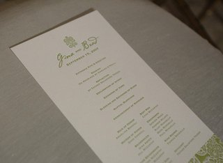 wedding-program-printed-on-white-paper-with-green-lettering