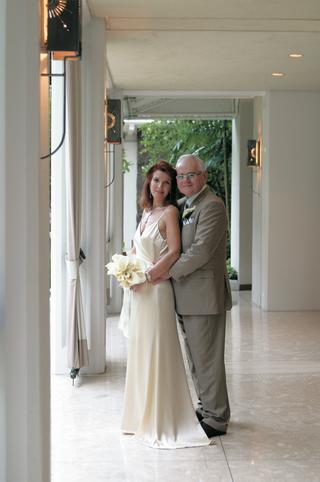 off-white-wedding-dress-and-groom-in-dark-khaki