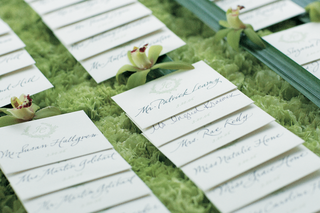 wedding-reception-place-cards-on-a-bed-of-green-flowers