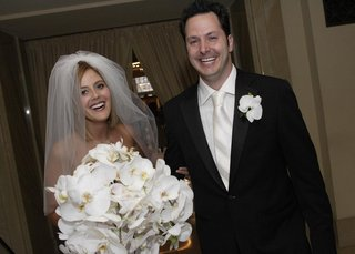 groom-and-bride-after-ceremony-with-brides-orchid-bouquet