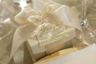 white-gift-box-with-white-satin-ribbon-and-green-grazie-tag