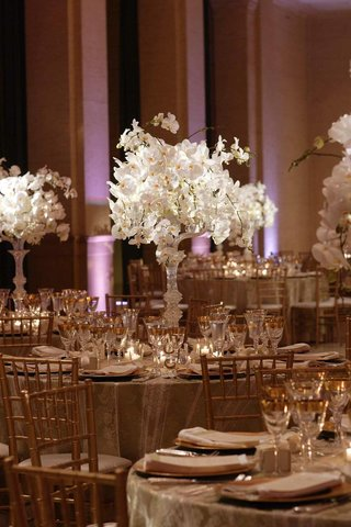 champagne-and-gold-reception-room-with-white-floral-centerpieces
