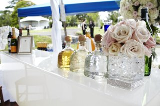 a-variety-of-alcohol-is-served-at-a-weddings-cocktail-hour-in-hawaii