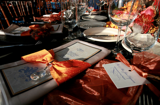 wedding-reception-menu-wrapped-with-orange-ribbon-and-crystal