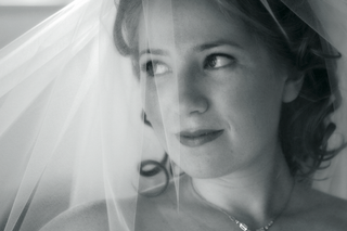black-and-white-photo-of-bride-under-veil
