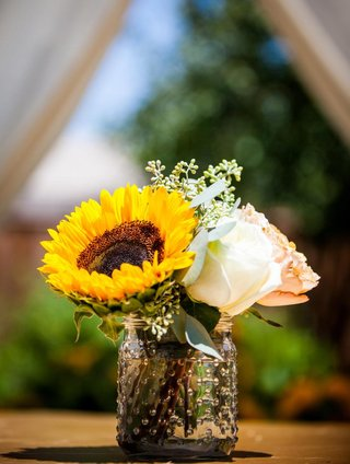 glass-mason-jar-with-sunflower-and-rose-centerpice