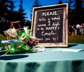 chalkboard-sign-for-wedding-wand-at-outdoor-ceremony