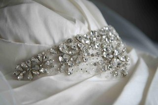 enuka-okumas-crystal-sash-on-her-wedding-dress