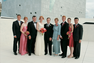 wedding-guests-on-rooftop-with-bride-and-groom