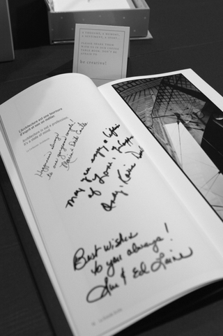 black-and-white-image-of-signed-coffee-table-guest-book