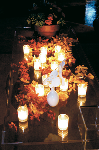 tropical-flowers-covering-candlelit-table