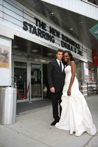 actress-enuka-okuma-and-husband-in-front-of-theater-marquee