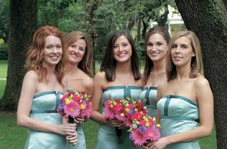 teal-bridesmaid-gowns-with-colorful-bouquets
