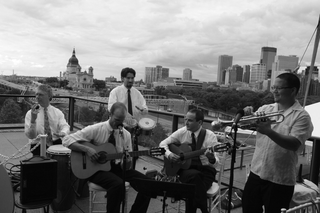 black-and-white-picture-of-five-piece-band-on-rooftop