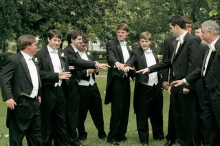 men-in-long-tail-tuxedos-with-ivory-vests