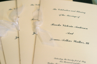 off-white-ceremony-booklet-with-shiny-ribbon