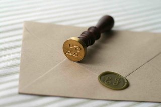 custom-wax-seal-stamp-with-dark-wood-handle-and-gold-stamper