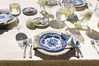 sun-drenched-table-with-blue-and-white-china