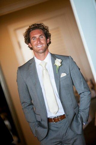 jeffrey-barnett-stunt-man-groom-in-grey-pinstripe-suit