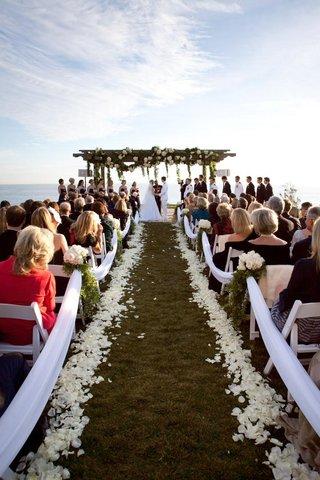 ivory-petal-lined-aisle-and-wedding-canopy