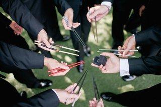 groomsmen-holding-mismatched-chopsticks