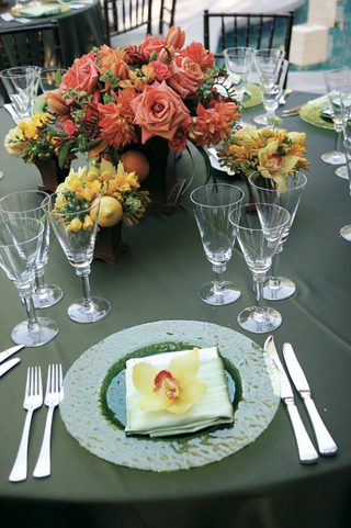 green-table-with-yellow-and-orange-flower-centerpieces