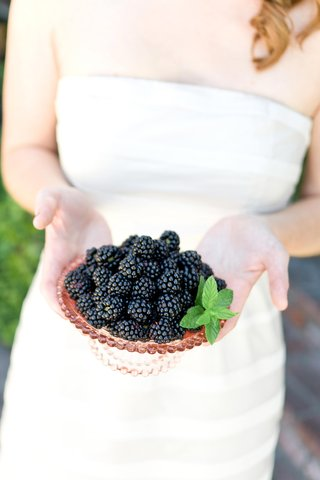 bride-to-be-holds-bowl-of-fruit