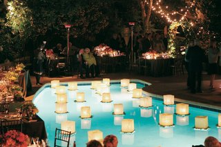 lily-pads-topped-with-paper-lanterns-on-top-of-pool