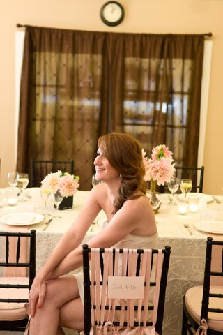 future-bride-sits-at-bridal-shower