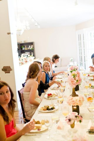 guests-sit-at-long-table-to-eat
