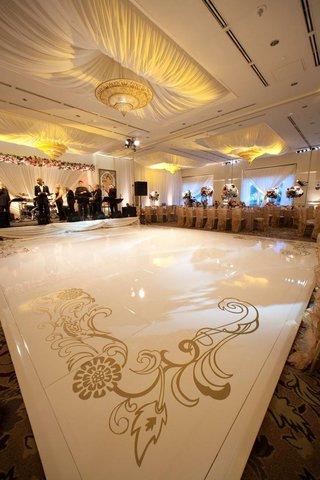 white-dance-floor-with-gold-artistic-design-at-corners