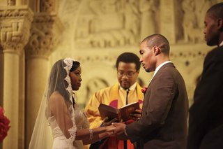 african-american-bride-and-groom-at-church-altar