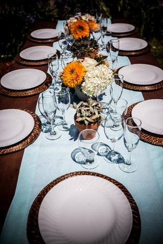 rattan-charger-plates-with-light-blue-table-runner