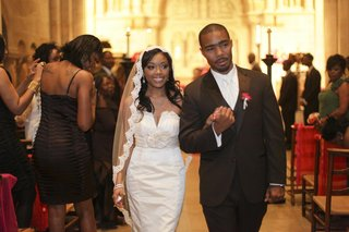 bride-and-groom-walk-hand-in-hand-up-the-church-aisle
