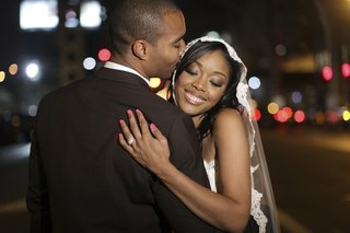 bride-in-lace-veil-hugging-groom-in-new-york-city