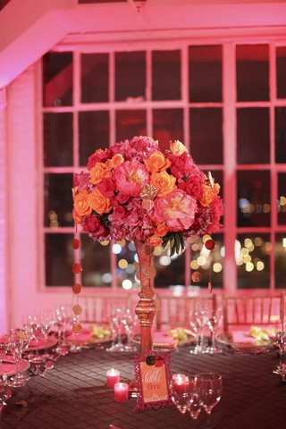 gold-centerpiece-stand-with-pink-and-orange-flowers