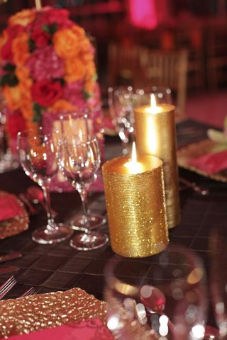 orange-and-pink-flowers-and-golden-glitter-candle