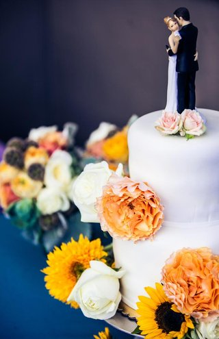 white-two-layer-wedding-cake-with-traditional-cake-topper