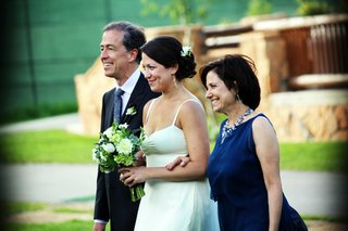 bride-walks-down-aisle-with-mother-and-father