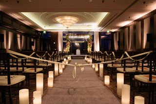 candles-on-aisle-runner-ribbon-country-club-ballroom-natural-winter-chuppah-ceremony-structure