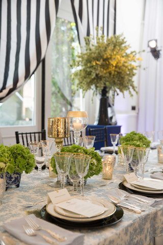 blue-and-white-table-setting-green-flower-arrangement-southern-inspired-wedding-low-centerpieces