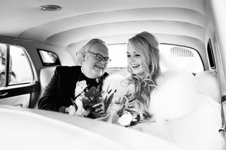 black-and-white-photo-of-bride-and-her-father-on-their-way-to-the-ceremony