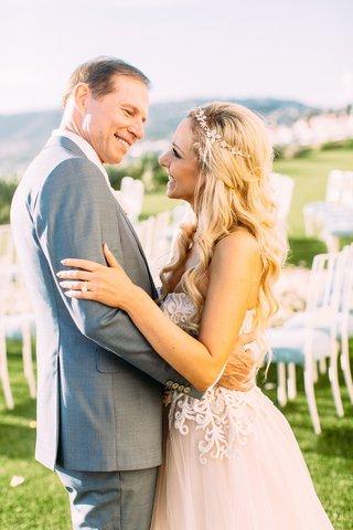 bride-in-custom-trish-peng-wedding-dress-blush-undertones-grey-suit-for-groom-ceremony-portrait
