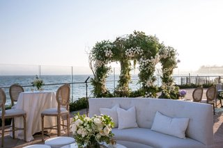 wedding-overlooking-ocean-in-santa-barbara-reception-outdoors-lounge-area-cocktail-hour-tufted