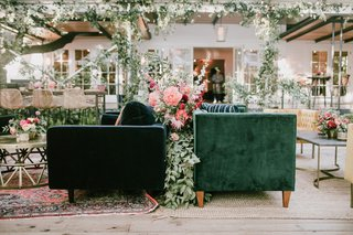 wedding-reception-lounge-boho-bohemian-design-layered-rug-velvet-furniture-rattan-vintage-decor